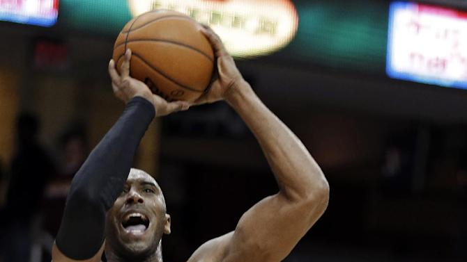 Los Angeles Lakers' Kobe Bryant (24) shoots against Cleveland Cavaliers' Alonzo Gee in the third quarter of an NBA basketball game, Tuesday, Dec. 11, 2012, in Cleveland. Bryant scored 41 points, but the Cavaliers won 100-94. (AP Photo/Mark Duncan)
