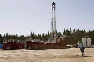 A worker walks from a shale gas drillng rig, on March 25, 2009 in Saint-Edouard-de-Lotbiniere Que. THE CANADIAN PRESS/Jacques Boissinot