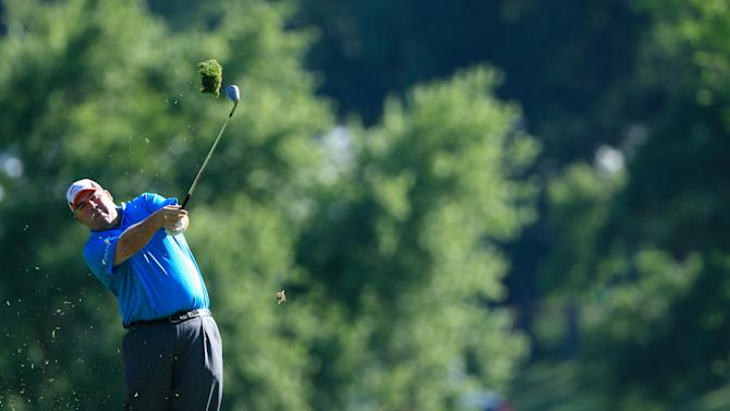 Kevin Stadler of the United States watches his approach shot on the second hole during the third round of the Travelers Championship golf tournament at the TPC River Highlands on June 21, 2014 in Cromwell, Connecticut
