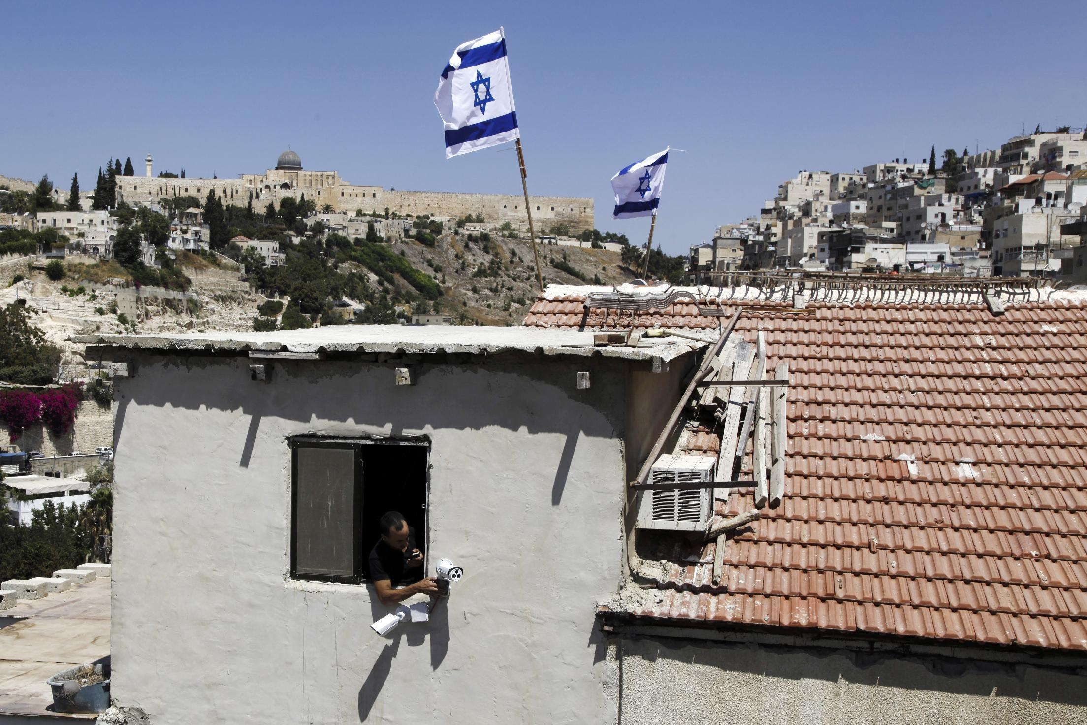 Jewish settlers take over homes in Arab part of Jerusalem