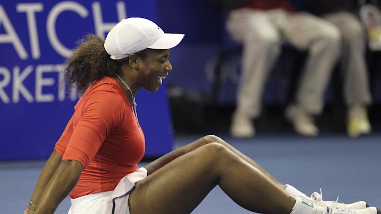 Serena Williams reacts after a drop shot from sister Venus, during their 'Breaking the Mould' exhibition tennis match at Ellis Park Indoor Arena in Johannesburg, South Africa, on Sunday Nov. 4, 2012. (AP Photo/Themba Hadebe)