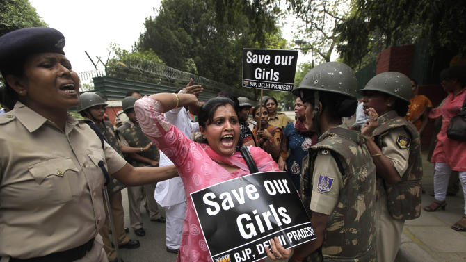 An Indian women activist of India main opposition Bharatiya Janata Party shouts slogans outside ruling United Progressive Alliance chairperson Sonia Gandhi's residence during a protest against the rape of a 5-year-old girl in New Delhi, India, Sunday, April 21, 2013. The girl was raped and tortured by a man who held her in a locked room in India's capital for two days. (AP Photo/Manish Swarup)