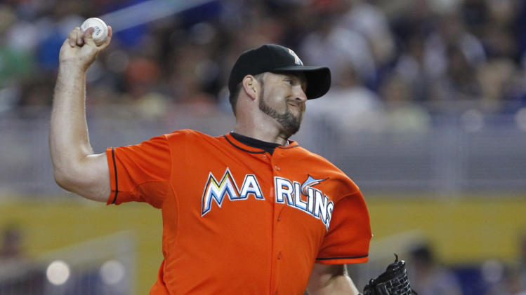 In this July 29, 2012, photo, Miami Marlins' Heath Bell pitches during a baseball game against the San Diego Padres in Miami. The Marlins traded Bell to the Arizona Diamondbacks on Saturday, Oct. 20, 2012. (AP Photo/Wilfredo Lee)