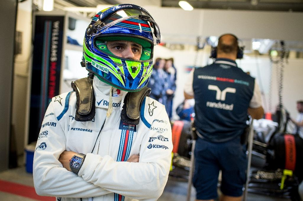 Massa tops times in forlorn rain-hit practice
