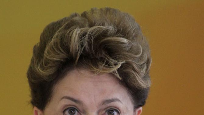 """Brazil's President Dilma Rousseff speaks during a ceremony where she announced an economic stimulus package at the Planalto presidential palace in Brasilia, Brazil, Wednesday, June 27, 2012.  The program announced by Rousseff focuses on a wide array of government purchases, from backhoes to motorcycles to military equipment. Rousseff says the government will use stimulus packages """"without restriction"""" as Brazil is hit by the crisis in Europe and hobbled by slowing domestic consumer demand.  (AP Photo/Eraldo Peres)"""