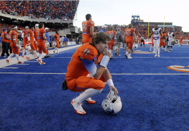 Boise State quarterback Kellen Moore reacts after losing to 36-35 to TCU in an NCAA college football game on Saturday, Nov. 12, 2011 in Boise, Idaho. (AP Photo/Idaho Press-Tribune, Charlie Litchfield)
