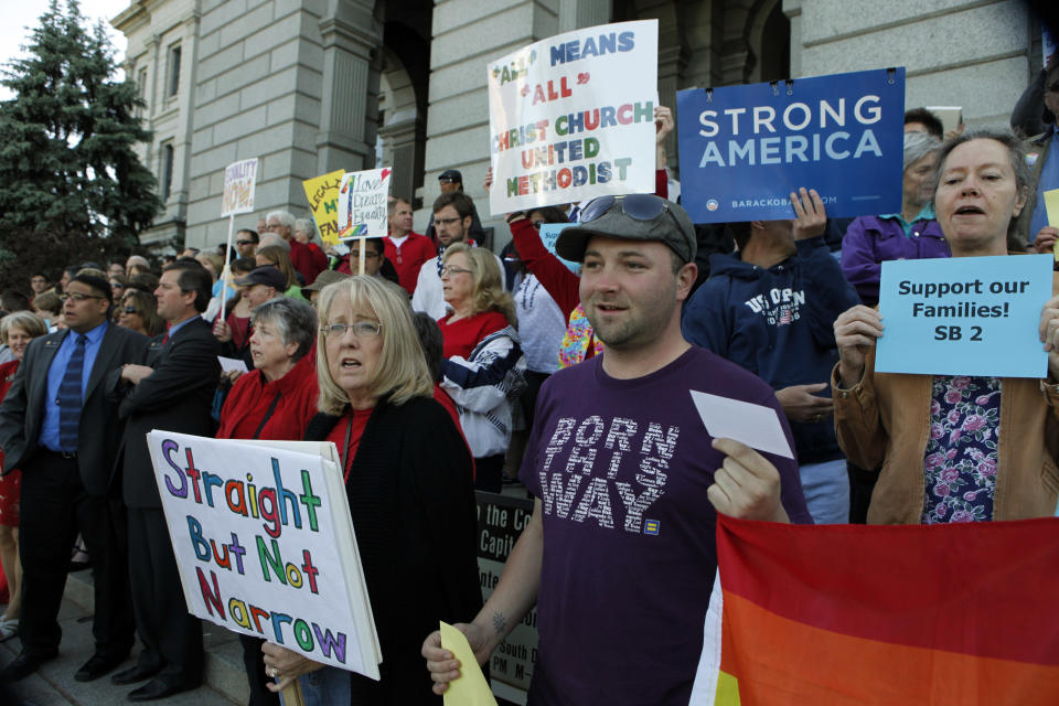 Supporters of Civil Unions rally at the Capitol in Denver on Monday, May 14, 2012. Colorado lawmakers were called back into a special session on Monday to vote on several bills including Civil Unions. (AP Photo/Ed Andrieski)
