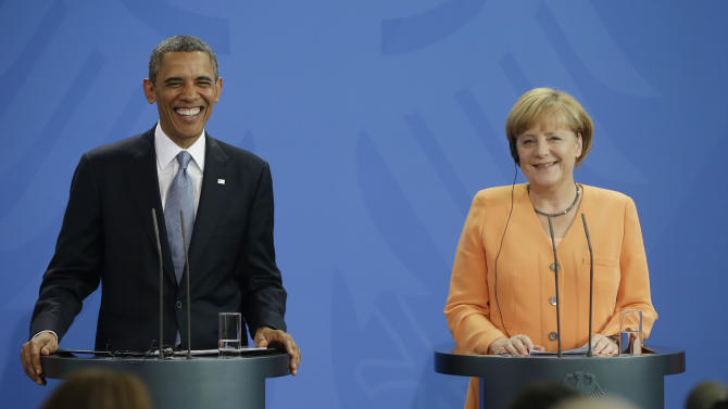 US President Barack Obama, left, and German Chancellor Angela Merkel, right, both smile during a lighter moment in their joint news conference at the Chancellery in Berlin, Germany, Wednesday, June 19, 2013. Obama will renew his call to reduce the world's nuclear stockpiles, including a proposed one-third reduction in U.S. and Russian arsenals, a senior administration official said. (AP Photo/Pablo Martinez Monsivais)