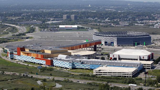"FILE- In this Thursday, Sept. 1, 2011 file photo, MetLife Stadium, rear right, and the Izod Center, middle right, are seen behind American Dream, formerly called Xanadu, the unfinished oddly patterned shopping and entertainment complex in East Rutherford, N.J. DreamWorks Animation, the Hollywood studio that created the green ogre, Shrek and the wisecracking zoo animals of ""Madagascar"" has announced plans for an indoor theme park as part of the megamall in New Jersey's Meadowlands. DreamWorks Animation CEO Jeffrey Katzenberg says the theme park 10 miles west of New York City will incorporate the studio's characters and storytelling. (AP Photo/Mel Evans, File)"