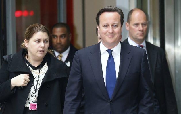 Britain's Prime Minister Cameron leaves the BBC's Broadcasting House in London