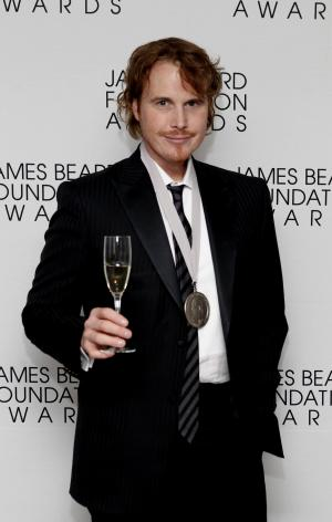 "In this May 7, 2012 file photo, chef Grant Achatz poses after his ""Who's Who of Food & Beverage in America"" induction during the James Beard Foundation Awards, in New York. At Alinea, the Chicago temple of theatrical molecular gastronomy, chef Grant Achatz has contemplated having servers choreograph their motions to the music of a live cellist. (AP Photo/Jason DeCrow, File)"