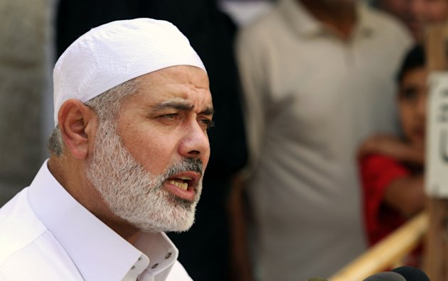 Gaza's Hamas Prime Minister Ismail Haniyeh speaks to the press after Friday prayers, in Gaza City, Friday, Sept. 23, 2011. Palestinian President Mahmoud Abbas is set to speak later Friday at the U.N., and plans to call on the world body to accept Palestine as a member. Hamas is opposed to the Palestinian Authority and has not expressed support for the statehood bid, which implies recognition of Israel. (AP Photo/Hatem Moussa)