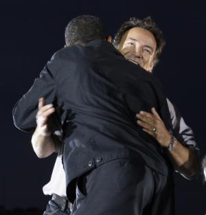 FILE - In this Nov. 2, 2008, file photo Bruce Springsteen hugs presidential candidate Barack Obama during a performance at an outdoor campaign rally at the Cleveland Mall, in Cleveland, Ohio. Springsteen is hitting the campaign trail again on President Barack Obama's behalf, and he'll be joined this time by former President Bill Clinton at a rally in Parma, Ohio, Thursday, Oct. 18, 2012. (AP Photo/Alex Brandon, File)