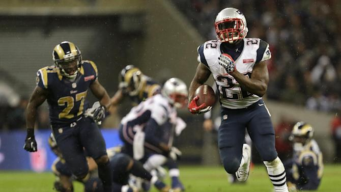 New England Patriots running back Stevan Ridley, right, with St. Louis Rams free safety Quintin Mikell, left, in action during the second half of a  NFL football game at Wembley Stadium, London, Sunday, Oct. 28, 2012. (AP Photo/Alastair Grant)