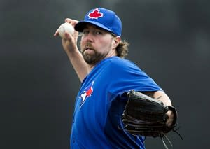 Toronto Blue Jays starting pitcher R.A. Dickey throws a warm up pitch while playing against the Boston Red Sox during first inning MLB Grapefruit League baseball action Dunedin, Fla., on Monday, Feb. 25, 2013. THE CANADIAN PRESS/Nathan Denette
