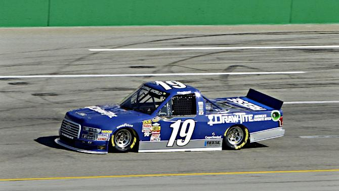NASCAR driver Brad Keselowski puts his NASCAR Truck Series vehicle through a practice lap at Kentucky Speedway in Sparta, Ky., Thursday morning, June 26, 2014. Keselowski will try to compete in all three NASCAR races this weekend in Kentucky