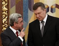 Ukrainian President Yanukovich and his Armenian counterpart Sarksyan talk after a signing ceremony in the Ukrainian capital Kiev