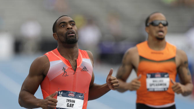 Tyson Gay, left, beats Wallace Spearmon, right, to the finish line in the senior men's 200-meter dash finals at the U.S. Championships athletics meet on Sunday, June 23, 2013, in Des Moines, Iowa. Gay won the race in 19.74 seconds. (AP Photo/Charlie Neibergall)