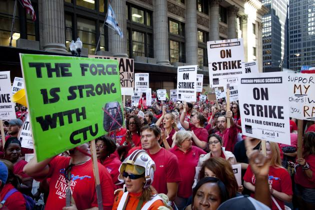 Thousands of public school teachers rally outside the Chicago Public Schools district headquarters on the first day of strike action over teachers' contracts on Monday, Sept. 10, 2012 in Chicago. For