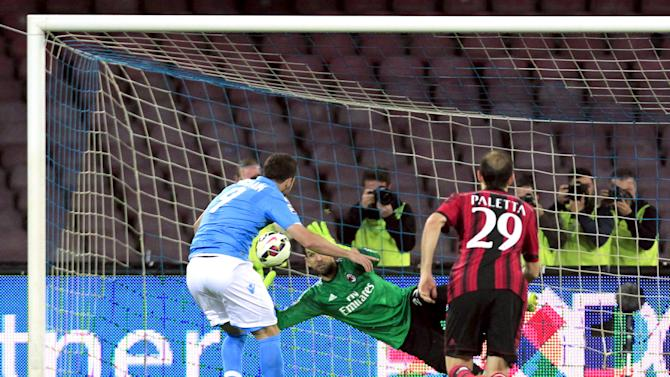 AC Milan's goalkeeper Diego Lopez saves a penalty shot by Napoli's Higuain during their Italian Serie A soccer match at the San Paolo stadium in Naples