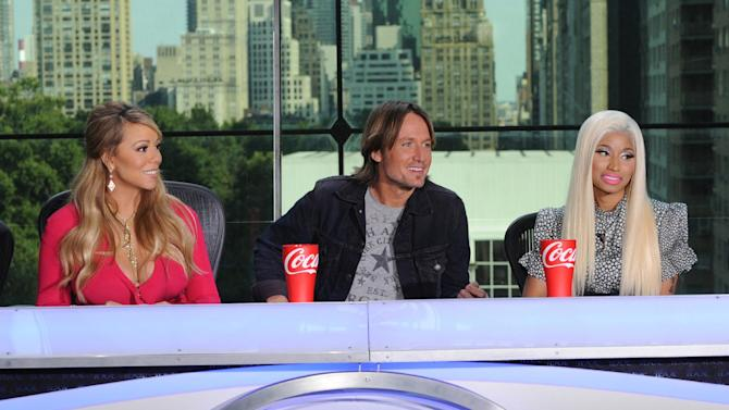 "FILE - ThisSept. 17, 2012 file image released by Fox shows the new judges for the singing competition series, ""American Idol,"" from left, Mariah Carey, Keith Urban and Nicki Minaj and during a news conference in New York. Carey told Barbara Walters her fellow ""American Idol"" judge Nicki Minaj threatened to shoot her, Walters reported on ABC's ""The View"" Thursday morning. After a meeting on Wednesday attended by the pair, Minaj said to Carey, ""I love you, but we might fight again,"" according to Walters. ""Mariah responded, 'No, we will not.'"" (AP Photo/FOX, Michael Becker)"