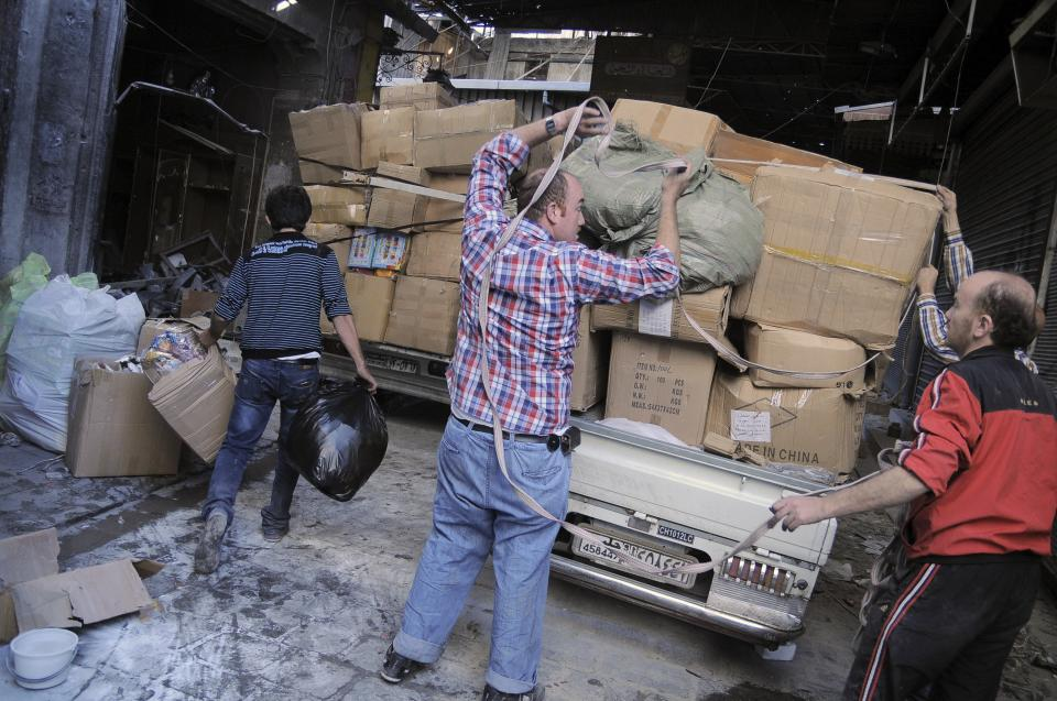 In this Tuesday, Nov. 6, 2012 photo, merchants remove their wares from the souk in the Old City of Aleppo, Syria.(AP Photo/Monica Prieto)
