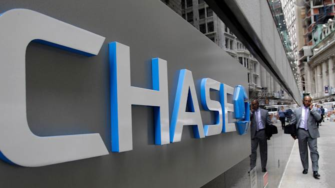 FILE - This Oct. 12, 2011 file photo shows the J.P. Morgan Chase logo at the base of one of the bank's larger Lower Manhattan buildings in New York. JPMorgan Chase said Friday, Jan. 13, 2012, its income fell 23 percent in the fourth quarter of 2011 after the bank set aside a large sum for litigation reserves and its investment banking income declined. (AP Photo/Kathy Willens, File)