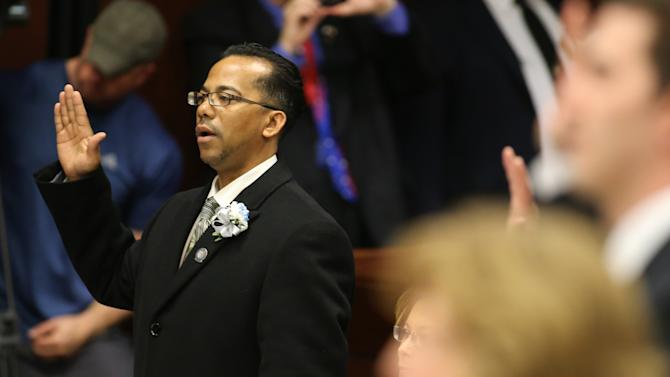 Embattled Nevada Assemblyman Steven Brooks, D-North Las Vegas, takes the oath of office during the opening day of the 77th Legislative Session in Carson City, Nev. on Monday, Feb. 4, 2013. Brooks was arrested Jan. 19 and accused of threatening incoming Democratic Speaker Marilyn Kirkpatrick. (AP Photo/Cathleen Allison)