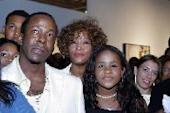 Bobby Brown, Whitney Houston and daughter Bobbi Kristina watch the premiere of 'Being Bobby Brown,' Atlanta, on June 27, 2005 -- Getty Premium
