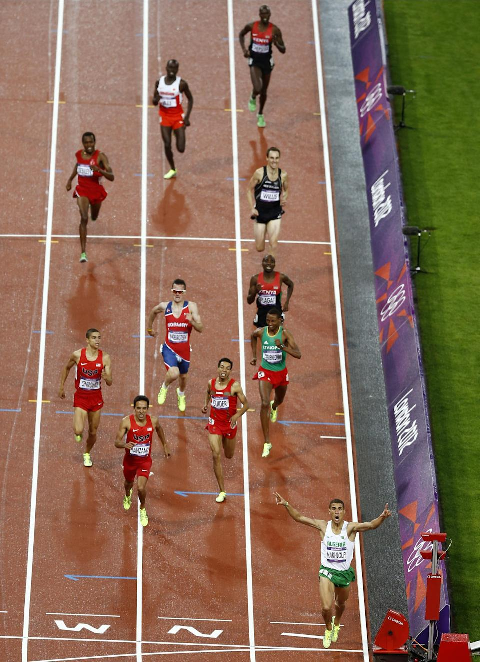 Algeria's Taoufik Makhloufi celebrates as he crosses the finish line to win the men's 1500-meters final during the athletics in the Olympic Stadium at the 2012 Summer Olympics, London, Tuesday, Aug. 7, 2012. (AP Photo/Daniel Ochoa De Olza)