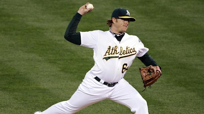 Oakland Athletics pitcher A.J. Griffin delivers in the first inning of Game 4 of their American League division baseball series against the Detroit Tigers in Oakland, Calif., Wednesday, Oct. 10, 2012. (AP Photo/Eric Risberg)