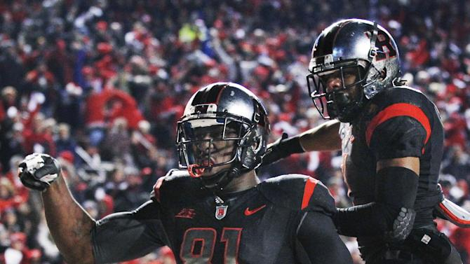 Rutgers wide receiver Mark Harrison (81) celebrates his touchdown with teammate Quron Pratt during the first half of an NCAA college football game against Louisville in Piscataway, N.J., Thursday, Nov. 29, 2012. (AP Photo/Mel Evans)