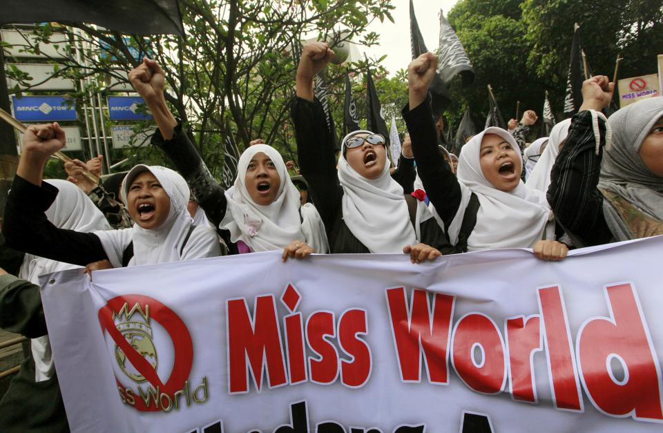 Muslim women chant slogans during a protest demanding the cancellation of the Miss World pageant that will be held in Bali and Sentul, West Java later this month, in Jakarta, Indonesia, Thursday, Sept. 5, 2013. Hundreds of Muslims staged the rally saying that such a competition violates Islamic teachings. (AP Photo/Dita Alangkara)