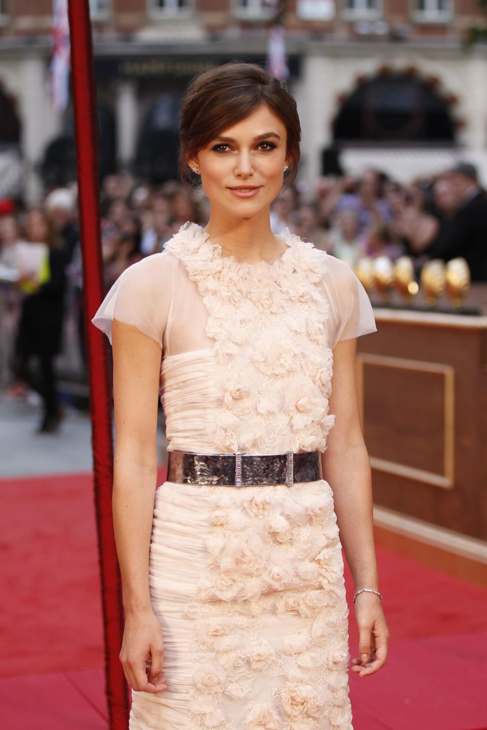 Cast member British actress Keira Knightley poses as she arrives for the world premiere of Anna Karenina in London, Tuesday, Sept. 4, 2012. (AP Photo/Sang Tan)