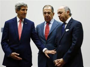 US Secretary of State Kerry gestures towards French…