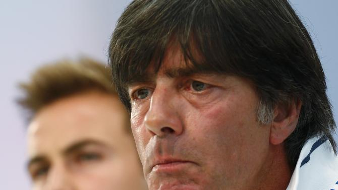 Loew, coach of German national soccer team and midfielder Goetze, attend news conference in Frankfurt