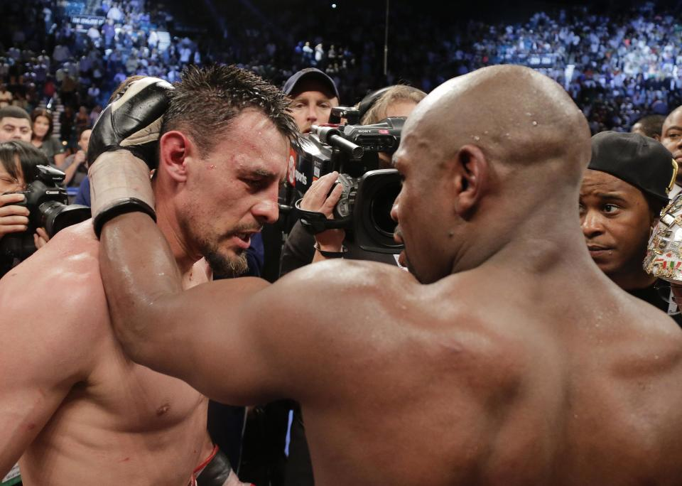 Floyd Mayweather Jr., right, talks with Robert Guerrero after beating him by unanimous decision during a WBC welterweight title fight, Saturday, May 4, 2013, in Las Vegas. (AP Photo/Rick Bowmer)