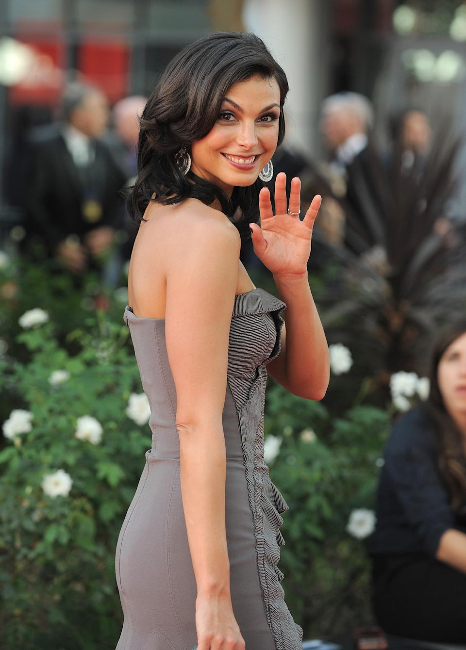 Actress Morena Baccarin arrives at the 64th Primetime Emmy Awards at the Nokia Theatre on Sunday, Sept. 23, 2012, in Los Angeles.  (Photo by Jordan Strauss/Invision/AP)