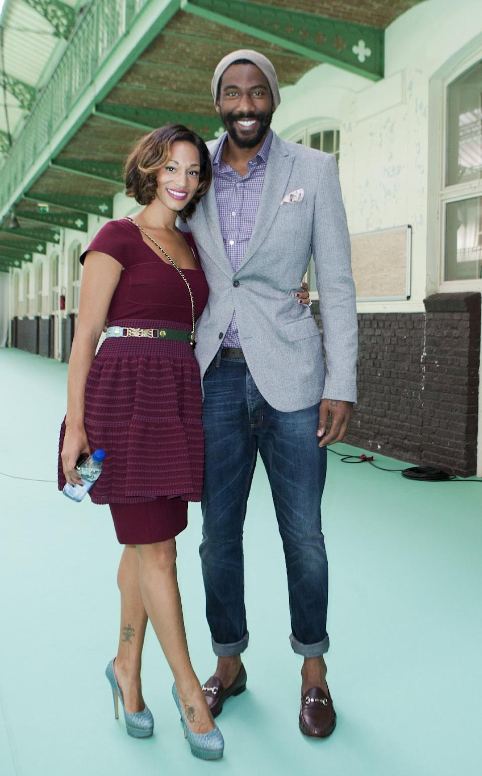 U.S basketball player Amare Stoudemire, right, and Alexis Welch poses prior to Paul Smith's Men's Spring-Summer 2013 collection, for Lanvin fashion house in Paris, France, Sunday, July 1, 2012. (AP Photo/Jacques Brinon)