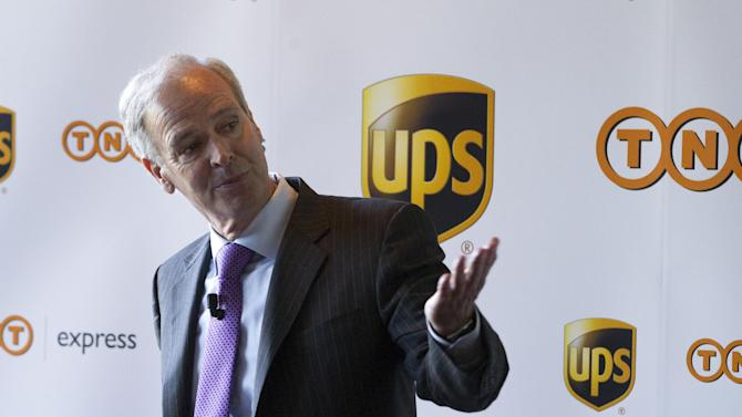 FILE - In this March 19, 2012 file photo Scott Davis, CEO of UPS, elaborates on the planned merger between UPS and TNT Express during a press conference in Amsterdam. United Parcel Service Inc. has ditched its euro5.2 billion (US$ 6.9 billion) takeover of TNT Express NV after learning that European regulators would reject the deal in its current form. (AP Photo/Peter Dejong, FILE)