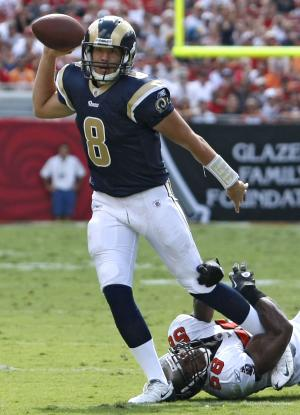 St. Louis Rams quarterback Sam Bradford (8) eludes a tackle by Tampa Bay Buccaneers linebacker Quincy Black (58) during the first half of an NFL football game, Sunday, Oct. 24, 2010, in Tampa, Fla. (AP Photo/Chris O'Meara)