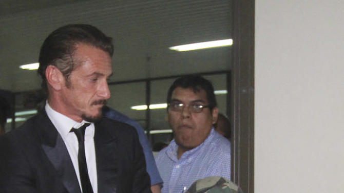 U.S. actor Sean Penn pushes U.S. businessman Jacob Ostreicher in a wheelchair, wearing a flak jacket, during a recess at Ostreicher's hearing in Santa Cruz, Bolivia, Tuesday, Dec. 11, 2012. A Bolivian appeals panel has refused to immediately release Ostreicher, despite evidence he was fleeced and extorted by prosecutors who have had him jailed for 18 months without charges on suspicion of money laundering. Ostreicher has been hospitalized for more than two weeks in a private clinic after being diagnosed with Parkinson's.  Ostreicher's case led to the uncovering of a shakedown ring allegedly run by the No. 1 legal advisor in the Interior Ministry, and including two prosecutors. It came after actor Sean Pean interceded with President Evo Morales. (AP Photo)