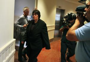 Lorinda Bailey enters a courtroom at the Denver Justice…