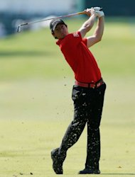 Rory McIlroy of Northern Ireland watches his approach on the 13th hole during the third round of the Tour Championship at East Lake Golf Club in Atlanta, Georgia