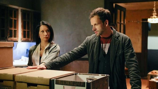 "This publicity image released by CBS shows Jonny Lee Miller, right, and Lucy Liu in a scene from the series, ""Elementary.""  (AP Photo/CBS, Giovanni Rufino)"