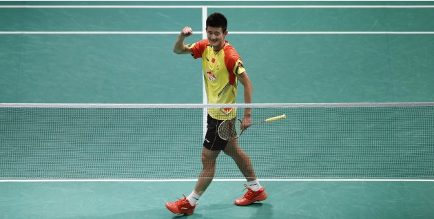 China's Chen celebrates after winning against South Korea's Lee during their men's singles match at the finals of the Sudirman Cup World Team Badminton Championships in Kuala Lumpur