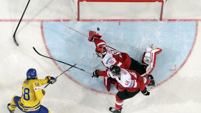 Sweden's Lander scores a goal past Austria's goaltender Swette and Iberer during their Ice Hockey World Championship game at the O2 arena in Prague