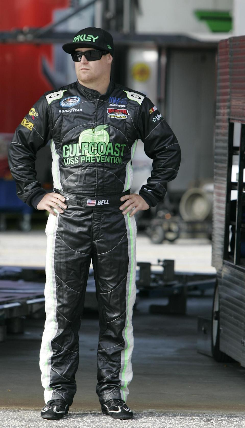 NASCAR driver T.J. Bell stands in the garage area at Darlington Raceway during practice for the Nationwide Series auto race, Friday, May 11, 2012 in Darlington, S.C. (AP Photo/Mary Ann Chastain)