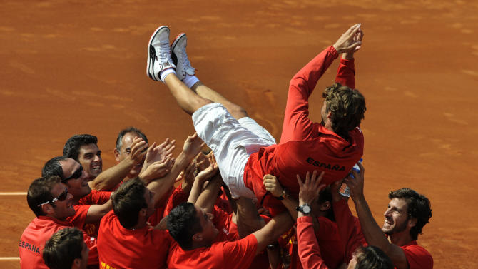 Juan Carlos Ferrero of Spain celebrates with his team mates after their victory over the U.S. at the Davis Cup semi-final at the Parque Hermanos Castro in Gijon