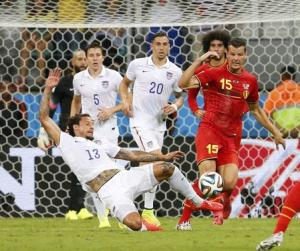 Jones of the U.S. fights for the ball with Belgium's Van Buyten during their 2014 World Cup round of 16 game at the Fonte Nova arena in Salvador